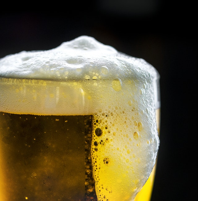 foaming beer in glass